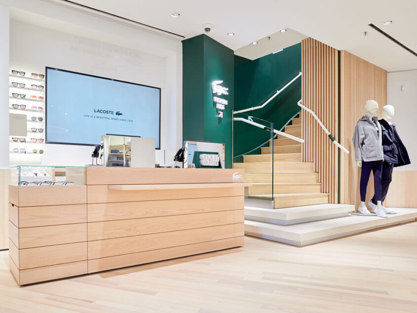 View on the cash desk/ stairway at Lacoste Ku'damm